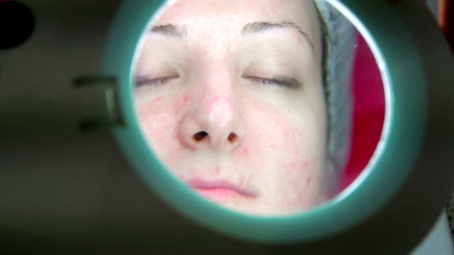 Doctor examining a patient's face video