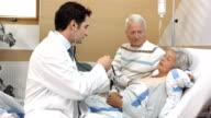 HD DOLLY: Doctor Examining Elderly Woman video