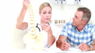 Doctor explaining anatomical spine to her patient video