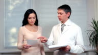 Doctor give prescription drug for female patient video