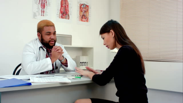 Doctor giving bad news to upset female patient video