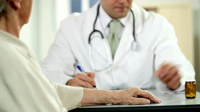 Doctor giving drugs to his patient video