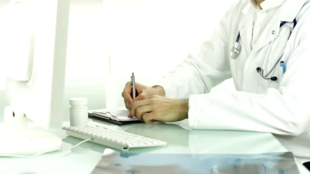 Doctor Hands Holding Xray Writing Diagnosis Prescription video
