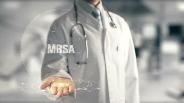 Doctor holding in hand MRSA video