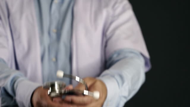 Doctor holding stethoscope video