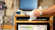 Doctor latex gloves in hospital video