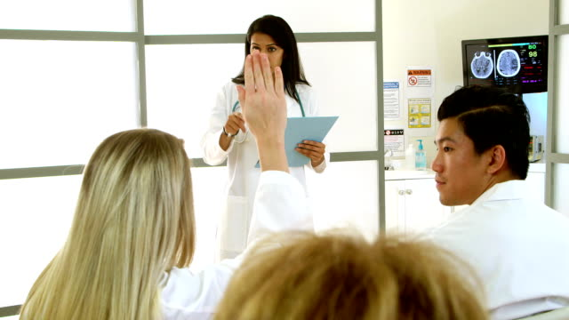 doctor leads meeting with medical interns video