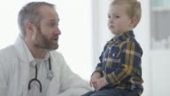 Doctor Listening to a Little Boy's Heartbeat video