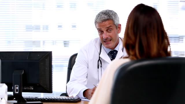 Doctor listening to patient video