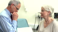 Doctor Listening To Senior Female Patient's Chest video