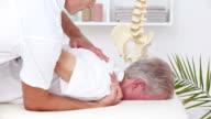 Doctor massaging his patient shoulder video