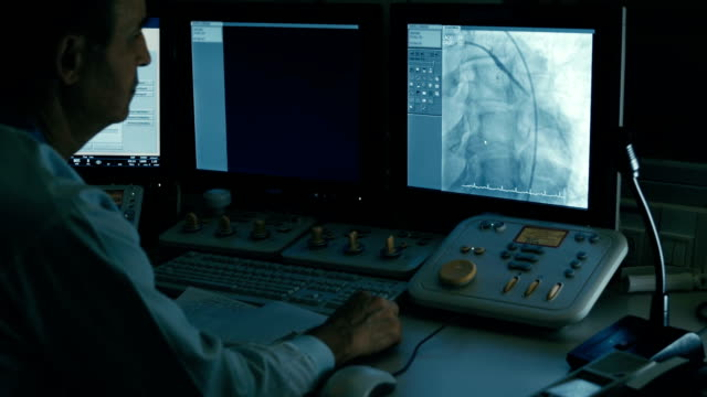 Doctor monitoring injection process into blood vessels video