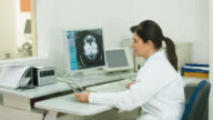 Doctor reading a CAT scan video