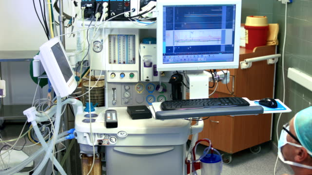 Doctor reads patient's vital indicators video