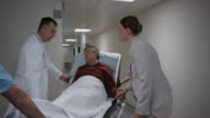 Doctor reassuring daughter and taking father to examining room video