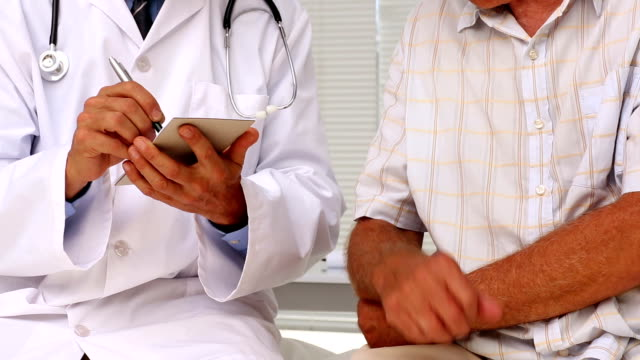 Doctor shaking hands with patient and giving prescription video