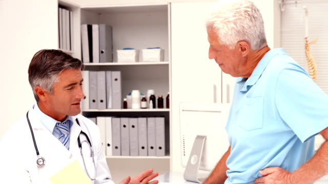 Doctor speaking with injured patient video