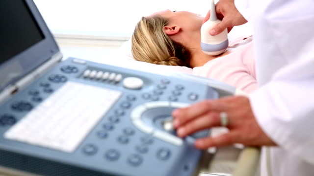 Doctor taking a sonogram of patients neck video