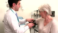 Doctor Taking Senior Female Patient's Blood Pressure video