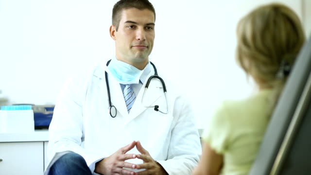 Doctor talking to a patient. video