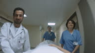 POV Doctor talking to patient being pushed on stretcher video