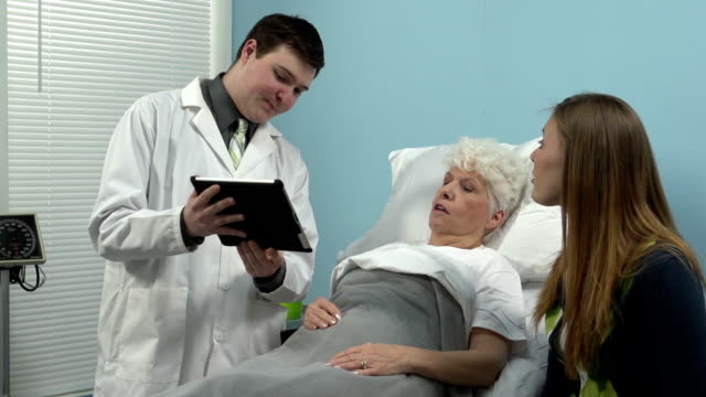 Doctor talking to patient using a tablet video