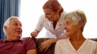 Doctor talking to senior couple video