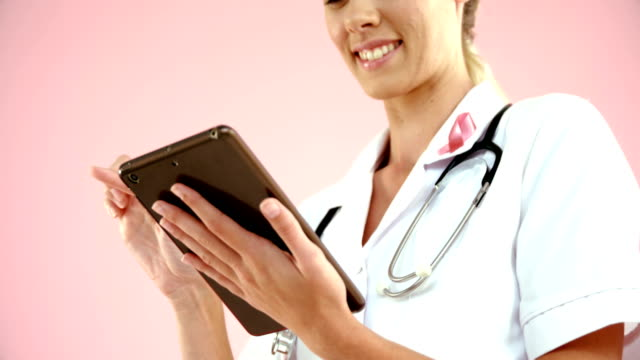 Doctor using digital tablet video