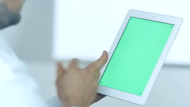 Doctor Using Digital Tablet with Green Screen video