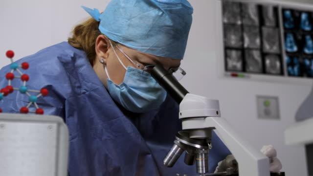 Doctor Using Microscope 3D Set (HD) video