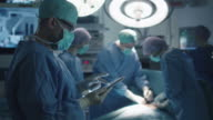 Doctor using Tablet in Operating Room. video