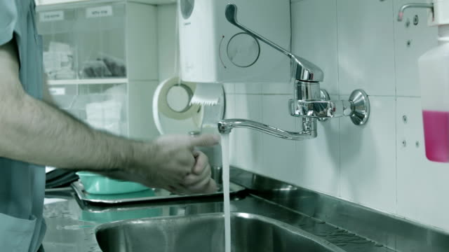 Doctor washes his hands before surgery video