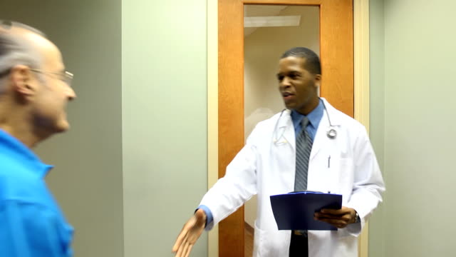 Doctor Welcomes Senior Male Patient video