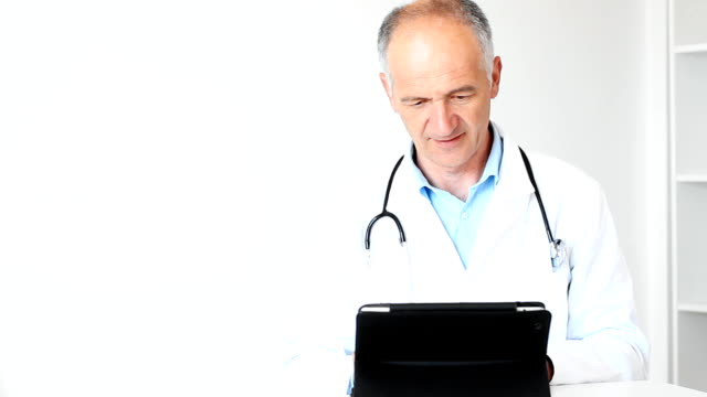 Doctor with digital tablet video