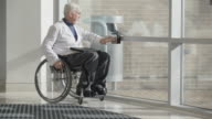 Doctor with Muscular Dystrophy using wheelchair video
