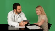 Doctor with tablet Discussing Patient In Clinic on a Green Screen, Chroma Key video