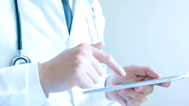 Doctor working on a digital tablet video