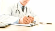Doctor writing down medical prescriptions video