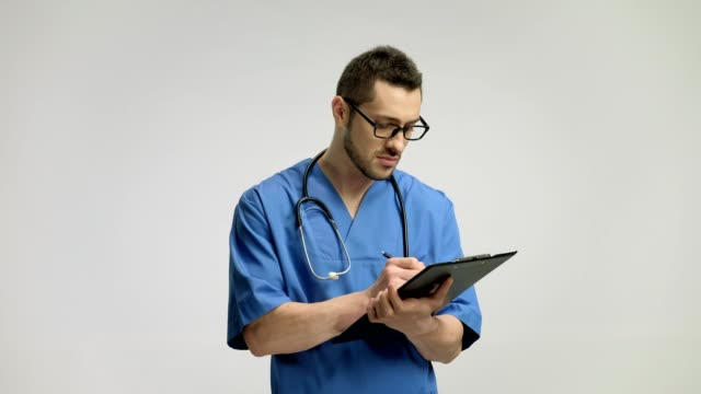 Doctor writing in a clipboard and smiling video