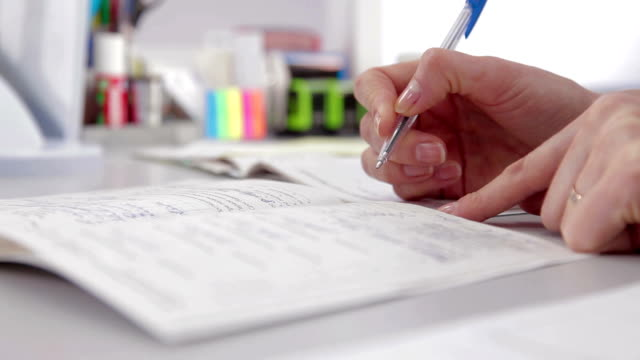 Doctor writing medical notes in hospital video
