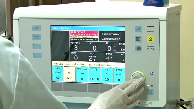 Doctor's hand with gloves adjusts surgical equipment video