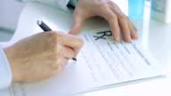 Doctors hand writting rx prescription video