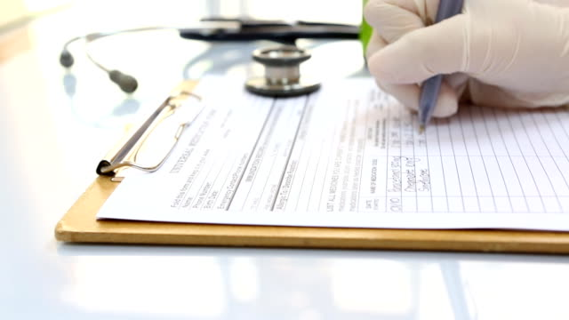 Doctor's handwriting on prescriptions,Dolly shot video