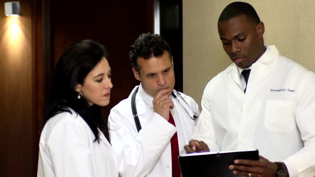 Doctors have Discussion Interacting with Digital Tablet - CU video