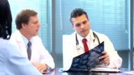 Doctors Review and Discuss Radiology Slides video