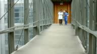 Doctors talking in the hallway video