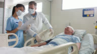 Doctors talking to patient at the ICU video