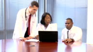 Doctors Use Laptop Computer and Discussing Case video