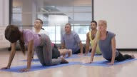 Doing Child's Pose in a Yoga Class video