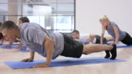 Doing Push-ups in an Indoor Fitness Class video